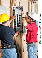 Electrical Breaker Panel Repair - Two electricians repairing...