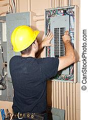 Industrial Electric Panel Repair - Electrician repairing...