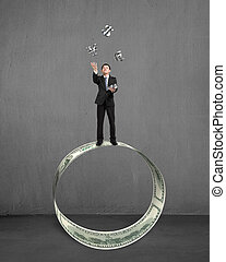 Businessman throwing and catching money symbols on money...