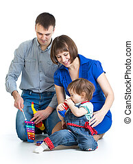 Happy family play musical toys