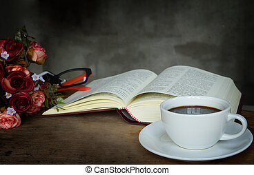 Still life cup of coffee,roses and book on old wooden table
