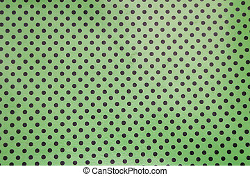 Black and green  - Black dots on a green background.