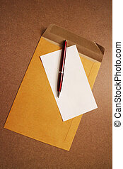 pens letter - Brown envelope with a pen and notebook paper.