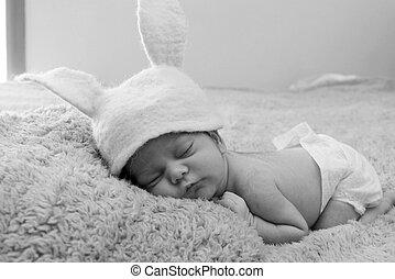 Funny sleeping newborn child