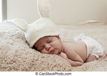 Funny sleeping newborn child