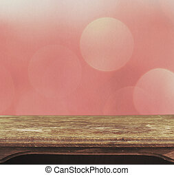 Vintage table on the background of pink bokeh patten