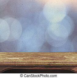 Vintage table on the background of bokeh blue patten
