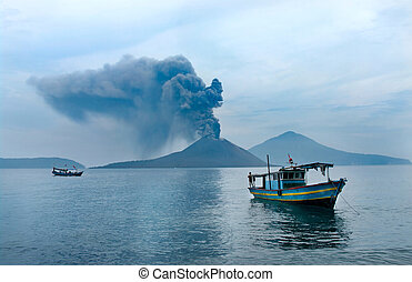 Boat near Anak Krakatau Volcano eruption Indonesia