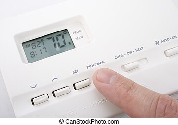 Climate control - Closeup shot of male hand adjusting...