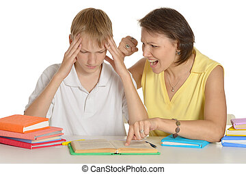 Bad pupil - Mother is angry at her son doing homework