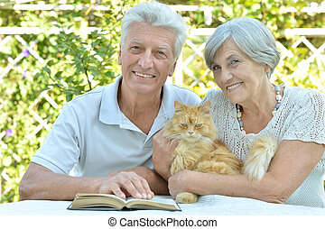Elderly couple with cat - Nice elderly couple with cat in a...