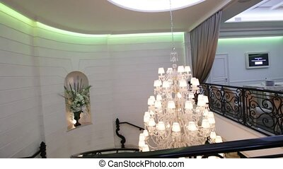 Luxury Crystal Chandelier - Camera is turned by elegant...