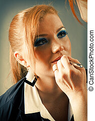 professional visagiste with red lipstick. - Which girl of a...