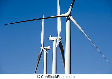 Wind turbines, blue sky.
