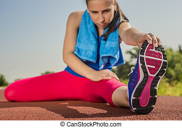 Athletic Woman - Stretches - Athletic woman stretches before...