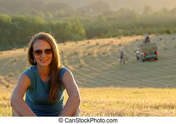 Teenage girl in a hayfield - Portrait of a pretty teen girl...