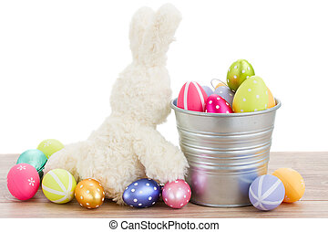fluffy easter bunny with eggs isolated on white background