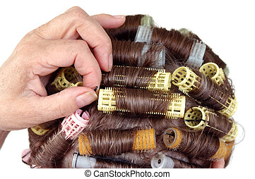 hair roller curlers - Senior citizen adjusting bobby pin...