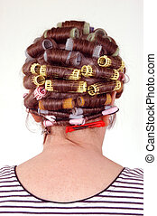 hair curlers - senior citizen female with hair rollers on...