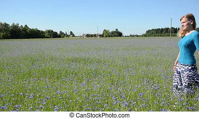 woman cornflower meadow