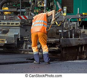 Workers - Road workers at the asphalt repairing works