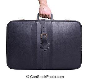 Man hand holding vintage leather travel bag