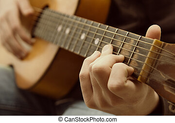 Acoustic guitar guitarist playing. Musical instrument with...