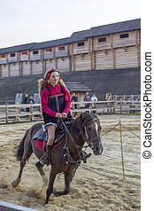 Girl on a horse - The girl in the national Ukrainian costume...