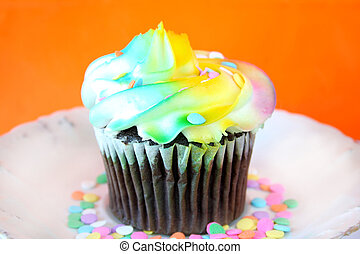 Cupcake - Single cupcake with multi colored icing and...