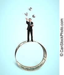 Businessman throwing and catching 3D sliver money symbols on...