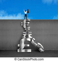Cheered businessman on top of wall with stack money symbols