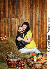 Young couple on hayloft - Young attractive couple playfully...