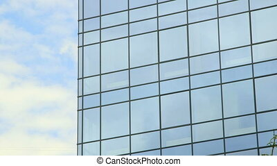Modern office building windows - Clouds reflected in windows...