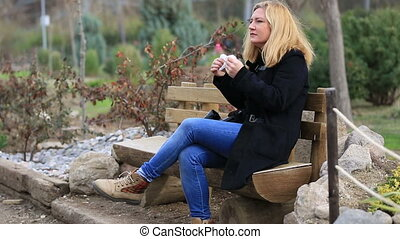 women sneezing - attractice blonde women sneezing outdoors