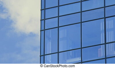 Glass facade of modern office building