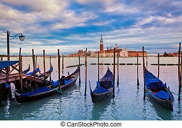 Gondolas and San Giorgio Maggiore church in Venice. -...