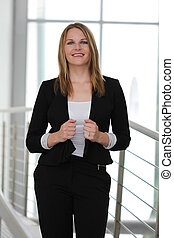 Businesswoman standing in a modern Building