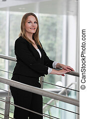 Businesswoman standing in a modern Building with a white...