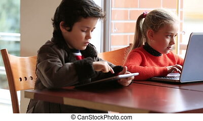 children studying at classroom