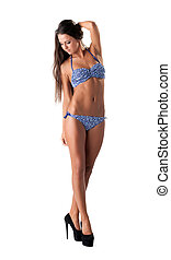 Studio shot of leggy model posing in blue bikini - Studio...