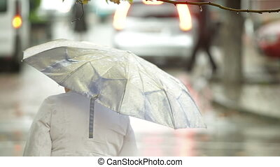 Woman with umbrella on a city street - Woman with umbrella...