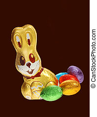 golden chocolate Easter bunny with eggs - A golden chocolate...