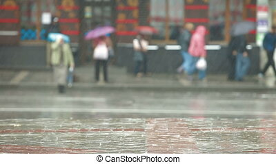 Rain in the city - Pedestrians and cars under rain on a city...