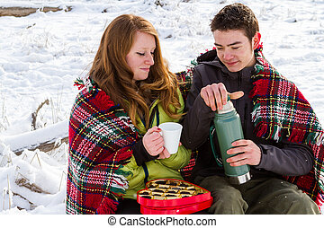 Valentines Day - Young couple at the picnic on the...