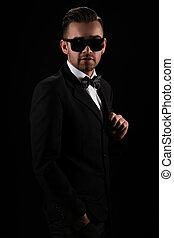 Gentleman. Attractive businessman in black suit - Attractive...