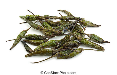 Pile of Dried Chillies - Dried green bird's eye chillies on...
