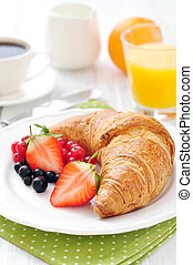 Fresh croissant with berries
