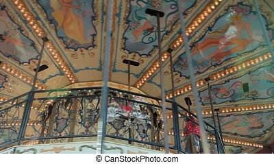 Merry-go-round carousel in amusement park