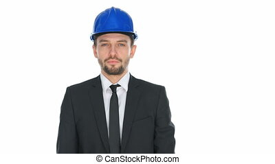Man wearing a hardhat speaking into a megaphone -...