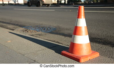 Traffic cone on asphalt surface